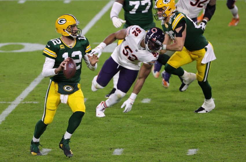 GREEN BAY, WISCONSIN - NOVEMBER 29: Aaron Rodgers #12 of the Green Bay Packers drops back to pass during a game against the Chicago Bears at Lambeau Field on November 29, 2020 in Green Bay, Wisconsin. The Packers defeated the Bears 45-21. (Photo by Stacy Revere/Getty Images)