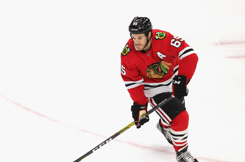 CHICAGO, ILLINOIS - FEBRUARY 04: Andrew Shaw #65 of the Chicago Blackhawks controls the puck against the Carolina Hurricanes at the United Center on February 04, 2021 in Chicago, Illinois. (Photo by Jonathan Daniel/Getty Images)