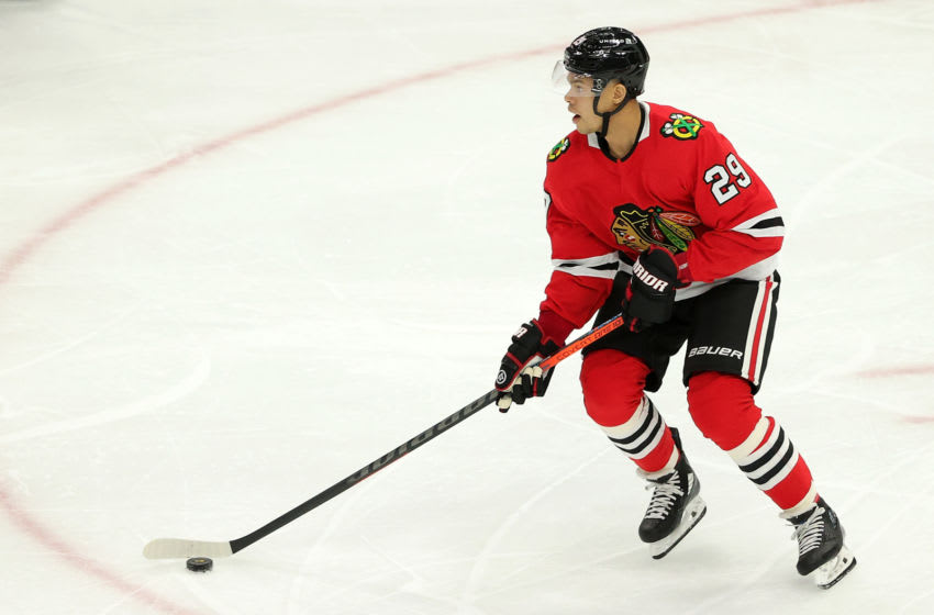 CHICAGO, ILLINOIS - FEBRUARY 11: Madison Bowey #29 of the Chicago Blackhawks controls the puck during a game against the Columbus Blue Jackets at the United Center on February 11, 2021 in Chicago, Illinois. The Blue Jackets defeated the Blackhawks 6-5. (Photo by Stacy Revere/Getty Images)