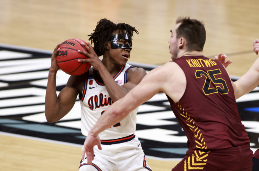 INDIANAPOLIS, INDIANA - MARCH 21: Ayo Dosunmu #11 of the Illinois Fighting Illini is guarded by Cameron Krutwig #25 of the Loyola-Chicago Ramblers during the first half in the NCAA Basketball Tournament second round at Bankers Life Fieldhouse on March 21, 2021 in Indianapolis, Indiana. (Photo by Justin Casterline/Getty Images)