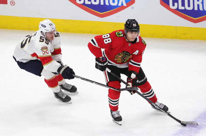 CHICAGO, ILLINOIS - MARCH 23: Patrick Kane #88 of the Chicago Blackhawks looks to pass under pressure from Noel Acciari #55 of the Florida Panthers at the United Center on March 23, 2021 in Chicago, Illinois. (Photo by Jonathan Daniel/Getty Images)