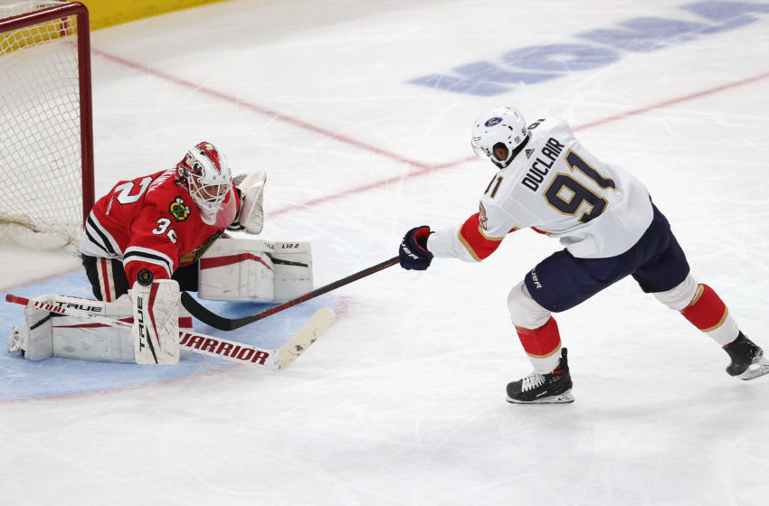 CHICAGO, ILLINOIS - MARCH 25: Kevin Lankinen #32 of the Chicago Blackhawks stops a shot by Anthony Duclair #91 of the Florida Panthers at the United Center on March 25, 2021 in Chicago, Illinois. (Photo by Jonathan Daniel/Getty Images)