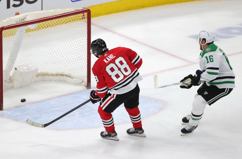 CHICAGO, ILLINOIS - APRIL 06: Patrick Kane #88 of the Chicago Blackhawks scores an empty net goal past Joe Pavelski #16 of the Dallas Stars at the United Center on April 06, 2021 in Chicago, Illinois. The Blackhawks defeated the Stars 4-2 (Photo by Jonathan Daniel/Getty Images)