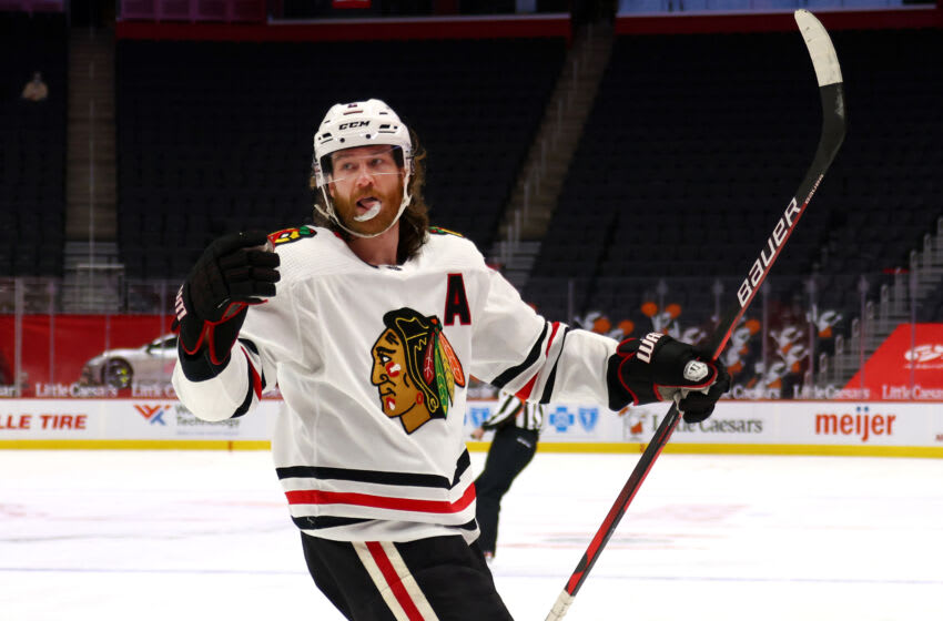 DETROIT, MICHIGAN - APRIL 15: Duncan Keith #2 of the Chicago Blackhawks celebrates his first period goal while playing the Detroit Red Wings at Little Caesars Arena on April 15, 2021 in Detroit, Michigan. (Photo by Gregory Shamus/Getty Images)