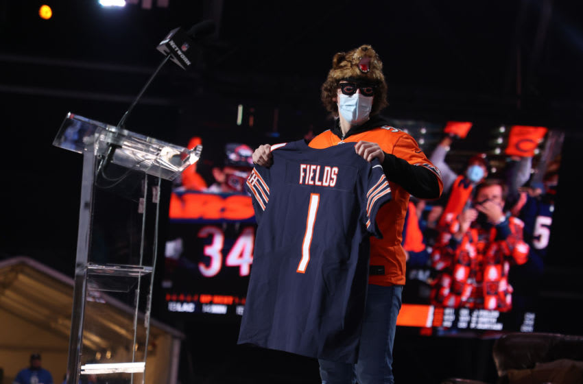 CLEVELAND, OHIO - APRIL 29: A fan holds a jersey after NFL Commissioner Roger Goodell announced Justin Fields being selected 11th by the Chicago Bears during round one of the 2021 NFL Draft at the Great Lakes Science Center on April 29, 2021 in Cleveland, Ohio. (Photo by Gregory Shamus/Getty Images)