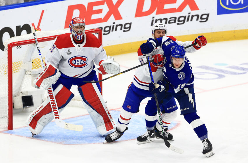 TAMPA, FLORIDA - JULY 07: Ondrej Palat #18 of the Tampa Bay Lightning and Shea Weber #6 of the Montreal Canadiens battle in front of Carey Price #31 during the first period in Game Five of the 2021 NHL Stanley Cup Final at Amalie Arena on July 07, 2021 in Tampa, Florida. (Photo by Mike Ehrmann/Getty Images)