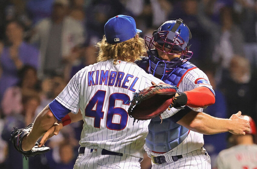 CHICAGO, ILLINOIS - JULY 07: Craig Kimbrel #46 of the Chicago Cubs gets a hug from Willson Contreras #40 after a win against the Philadelphia Phillies at Wrigley Field on July 07, 2021 in Chicago, Illinois. The Cubs defeated the Phillies 8-3. (Photo by Jonathan Daniel/Getty Images)