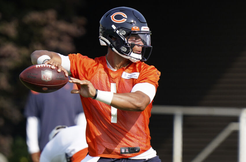 LAKE FOREST, ILLINOIS - JULY 29: Justin Fields #1 of the Chicago Bears throws a pass during training camp at Halas Hall on July 29, 2021 in Lake Forest, Illinois. (Photo by Nuccio DiNuzzo/Getty Images)