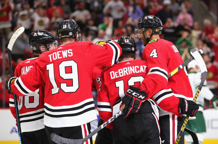 CHICAGO, ILLINOIS - OCTOBER 09: Jonathan Toews #19 of the Chicago Blackhawks celebrates his second goal of the night with teammates including (L-R) Patrick Kane #88, Alex DeBrincat #12 and Seth Jones #4 against the Minnesota Wild during a preseason game at the United Center on October 09, 2021 in Chicago, Illinois. The Blackhawks defeated the Wild 5-1. (Photo by Jonathan Daniel/Getty Images)