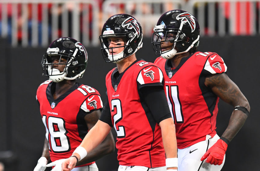 ATLANTA, GA - SEPTEMBER 23: Calvin Ridley #18, Matt Ryan #2, and Julio Jones #11 of the Atlanta Falcons take the field during the second quarter against the New Orleans Saints at Mercedes-Benz Stadium on September 23, 2018 in Atlanta, Georgia. (Photo by Scott Cunningham/Getty Images)