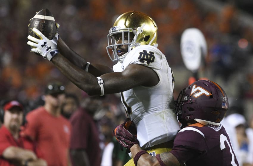 BLACKSBURG, VA - OCTOBER 6: Wide receiver Miles Boykin #81 of the Notre Dame Fighting Irish makes a reception while being defended by defensive back Jovonn Quillen #26 of the Virginia Tech Hokies in the second half at Lane Stadium on October 6, 2018 in Blacksburg, Virginia. (Photo by Michael Shroyer/Getty Images)
