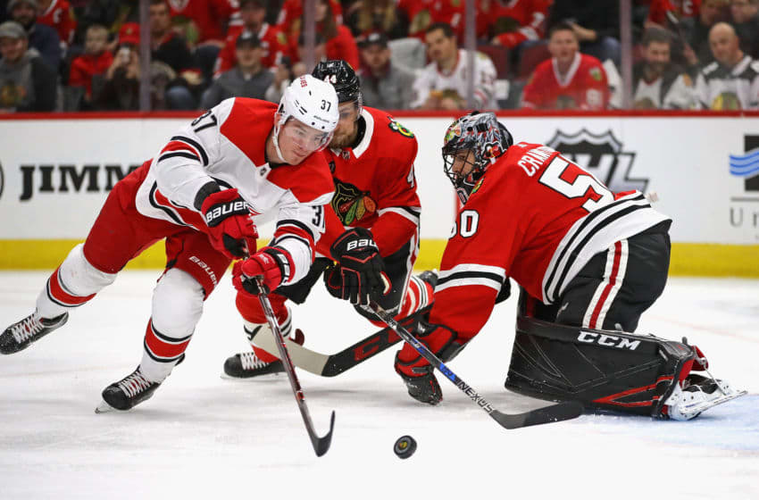 CHICAGO, IL - NOVEMBER 08: Andrei Svechnikov #37 of the Carolina Hurricanes pushes the puck past Corey Crawford #50 of the Chicago Blackhawks to score a first period goal at the United Center on November 8, 2018 in Chicago, Illinois. (Photo by Jonathan Daniel/Getty Images)