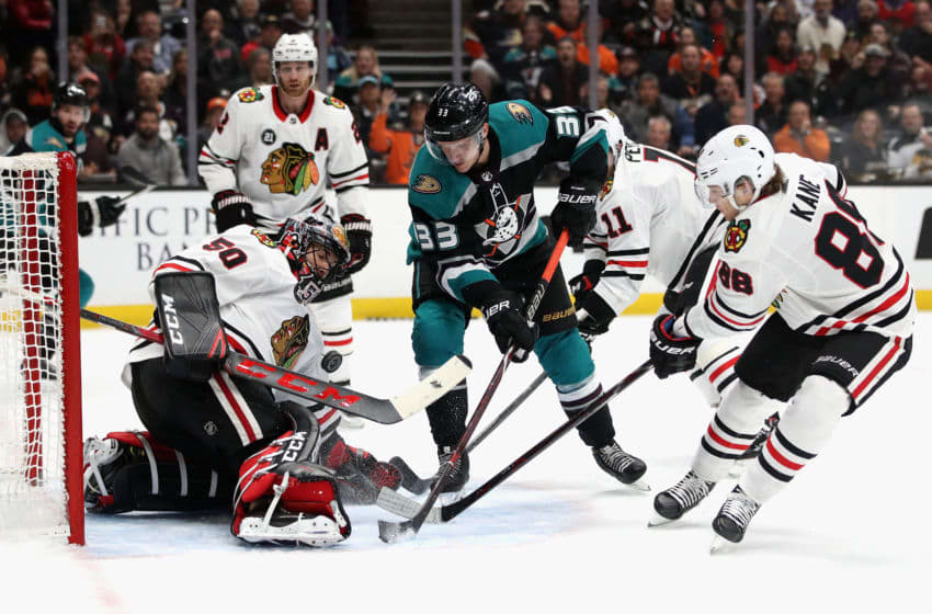 ANAHEIM, CA - DECEMBER 05: Corey Crawford #50 and Patrick Kane #88 of the Chicago Blackhawks defend against Anaheim Ducks shot by Jakob Silfverberg #33 of the Anaheim Ducks during the first period of a game at Honda Center on December 5, 2018 in Anaheim, California. (Photo by Sean M. Haffey/Getty Images)