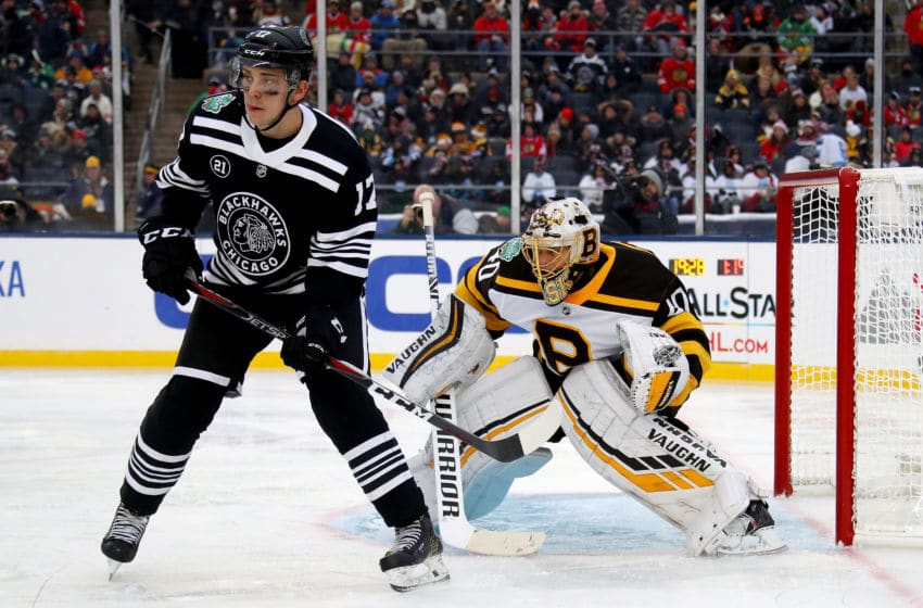 SOUTH BEND, INDIANA - JANUARY 01: Tuukka Rask #40 of the Boston Bruins plays goalie next to Dylan Strome #17 of the Chicago Blackhawks in the third period during the 2019 Bridgestone NHL Winter Classic at Notre Dame Stadium on January 01, 2019 in South Bend, Indiana. (Photo by Gregory Shamus/Getty Images)