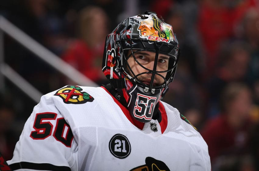 GLENDALE, ARIZONA - MARCH 26: Goaltender Corey Crawford #50 of the Chicago Blackhawks during the NHL game against the Arizona Coyotes at Gila River Arena on March 26, 2019 in Glendale, Arizona. (Photo by Christian Petersen/Getty Images)