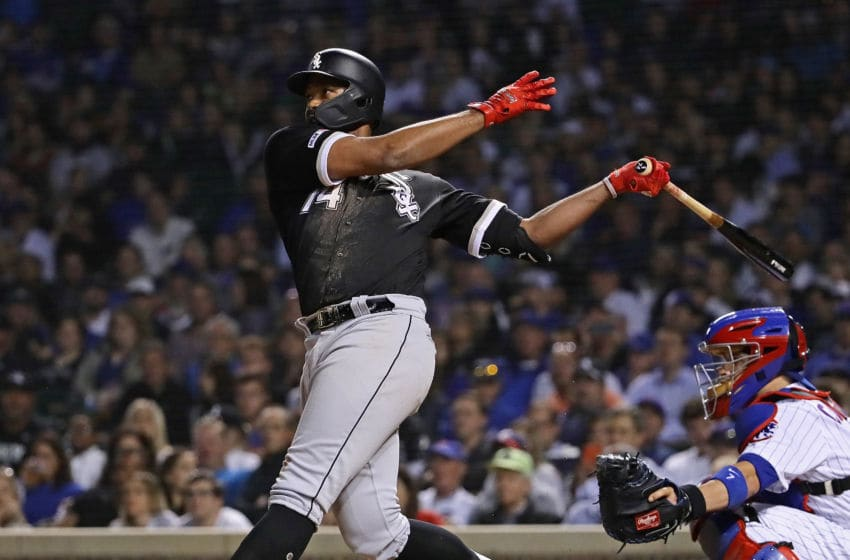 CHICAGO, ILLINOIS - JUNE 18: Eloy Jimenez #74 of the Chicago White Sox hits the game-winning, two run home run in the 9th inning against the Chicago Cubs at Wrigley Field on June 18, 2019 in Chicago, Illinois. (Photo by Jonathan Daniel/Getty Images)