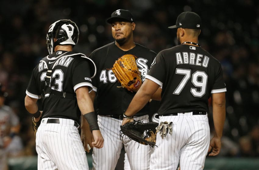 CHICAGO, ILLINOIS - SEPTEMBER 28: (L-R) James McCann #33 of the Chicago White Sox, Ivan Nova #46, and Jose Abreu #79 meet on the mound during the sixth inning of a game against the Detroit Tigers at Guaranteed Rate Field on September 28, 2019 in Chicago, Illinois. (Photo by Nuccio DiNuzzo/Getty Images)