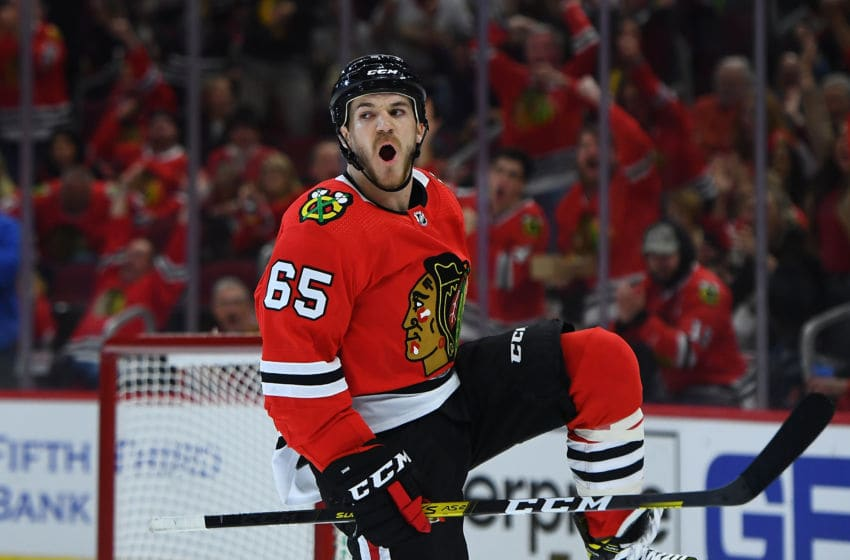 CHICAGO, ILLINOIS - OCTOBER 10: Andrew Shaw #65 of the Chicago Blackhawks celebrates a goal against the San Jose Sharks during the second period of the opening home game at United Center on October 10, 2019 in Chicago, Illinois. (Photo by Stacy Revere/Getty Images)