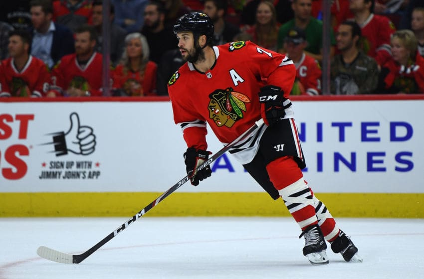 CHICAGO, ILLINOIS - OCTOBER 10: Brent Seabrook #7 of the Chicago Blackhawks controls the puck against the San Jose Sharks during the home opening game at United Center on October 10, 2019 in Chicago, Illinois. (Photo by Stacy Revere/Getty Images)