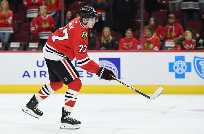 CHICAGO, ILLINOIS - OCTOBER 22: Kirby Dach #77 of the Chicago Blackhawks participates in warmups prior to a game against the Vegas Golden Knights at the United Center on October 22, 2019 in Chicago, Illinois. (Photo by Stacy Revere/Getty Images)