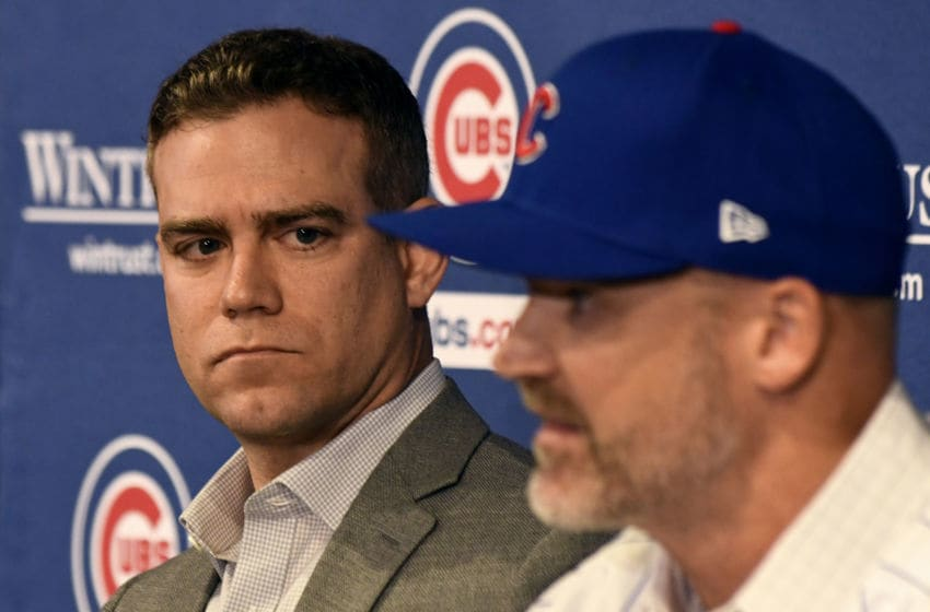 CHICAGO, ILLINOIS - OCTOBER 28: Theo Epstein, president of baseball operations of the Chicago Cubs, looks on as David Ross, new manager of the Cubs talks to the media during a press conference at Wrigley Field on October 28, 2019 in Chicago, Illinois. (Photo by David Banks/Getty Images)