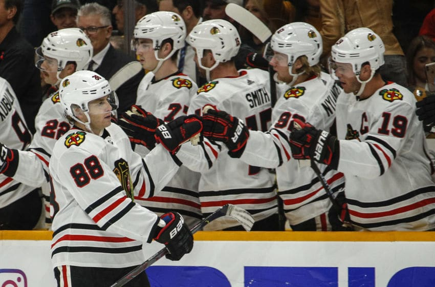 NASHVILLE, TENNESSEE - NOVEMBER 16: Patrick Kane #88 of the Chicago Blackhawks is congratulated by teammates Calvin de Haan #44 and Alex DeBrincat #12 after scoring a goal against the Nashville Predators during the third period at Bridgestone Arena on November 16, 2019 in Nashville, Tennessee. (Photo by Frederick Breedon/Getty Images)