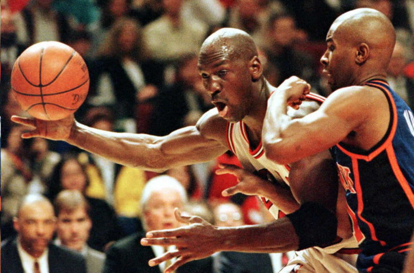 Michael Jordan (L) for the Chicago Bulls, and New York Knicks guard Charlie Ward scramble for the ball 14 May at the United Center in Chicago. The Bulls entered the game with a 3-1 record in the Eastern Conference Semi Finals. AFP PHOTO/Brian BAHR/vl (Photo by BRIAN BAHR / AFP) (Photo by BRIAN BAHR/AFP via Getty Images)