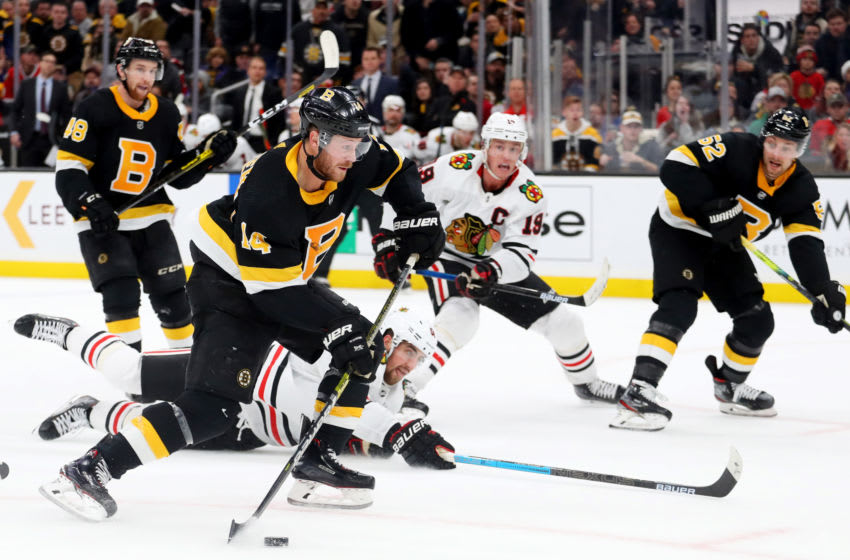 BOSTON, MASSACHUSETTS - DECEMBER 05: Chris Wagner #14 of the Boston Bruins takes a shot on goal during the third period at TD Garden on December 05, 2019 in Boston, Massachusetts. (Photo by Maddie Meyer/Getty Images)