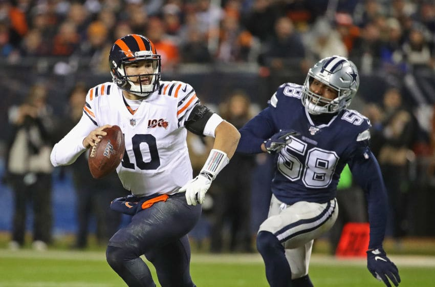 CHICAGO, ILLINOIS - DECEMBER 05: Mitchell Trubisky #10 of the Chicago Bears breaks away from Robert Quinn #58 of the Dallas Cowboys as he looks for a receiver at Soldier Field on December 05, 2019 in Chicago, Illinois. The Bears defeated the Cowboys 31-24. (Photo by Jonathan Daniel/Getty Images)