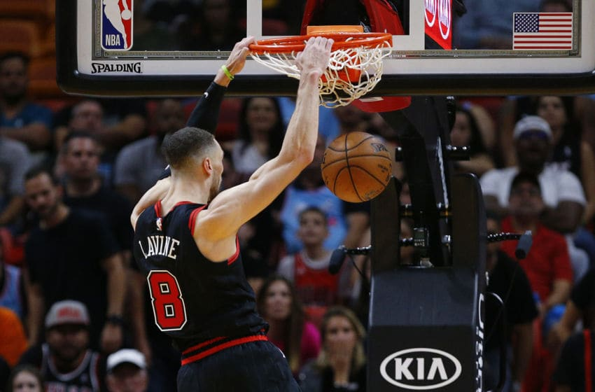 MIAMI, FLORIDA - DECEMBER 08: Zach LaVine #8 of the Chicago Bulls dunks against the Miami Heat during overtime at American Airlines Arena on December 08, 2019 in Miami, Florida. NOTE TO USER: User expressly acknowledges and agrees that, by downloading and/or using this photograph, user is consenting to the terms and conditions of the Getty Images License Agreement. (Photo by Michael Reaves/Getty Images)