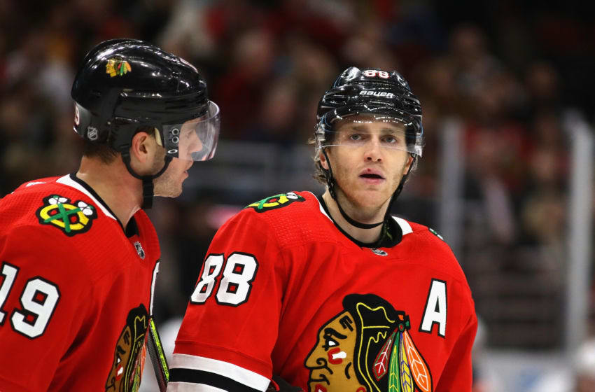 CHICAGO, ILLINOIS - DECEMBER 27: Jonathan Toews #19 of the Chicago Blackhawks talks with Patrick Kane #88 before a face-off against the New York Islanders at the United Center on December 27, 2019 in Chicago, Illinois. The Blackhawks defeated the Islanders 5-2. (Photo by Jonathan Daniel/Getty Images)