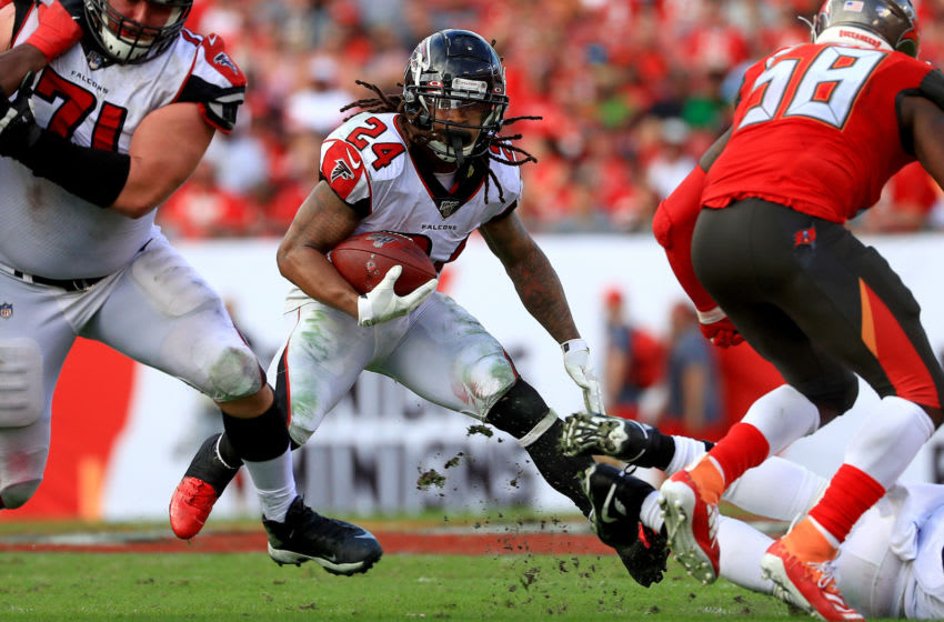 TAMPA, FLORIDA - DECEMBER 29: Devonta Freeman #24 of the Atlanta Falcons rushes during a game against the Tampa Bay Buccaneers at Raymond James Stadium on December 29, 2019 in Tampa, Florida. (Photo by Mike Ehrmann/Getty Images)