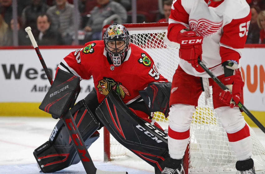 CHICAGO, ILLINOIS - JANUARY 05: Corey Crawford #50 of the Chicago Blackhawks minds the net against the Detroit Red Wings at the United Center on January 05, 2020 in Chicago, Illinois. (Photo by Jonathan Daniel/Getty Images)