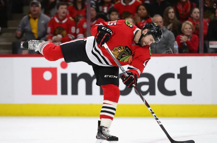 CHICAGO, ILLINOIS - JANUARY 07: Zack Smith #15 of the Chicago Blackhawks fires a shot against the Calgary Flames but was called for a high stick on the advance at the United Center on January 07, 2020 in Chicago, Illinois. (Photo by Jonathan Daniel/Getty Images)