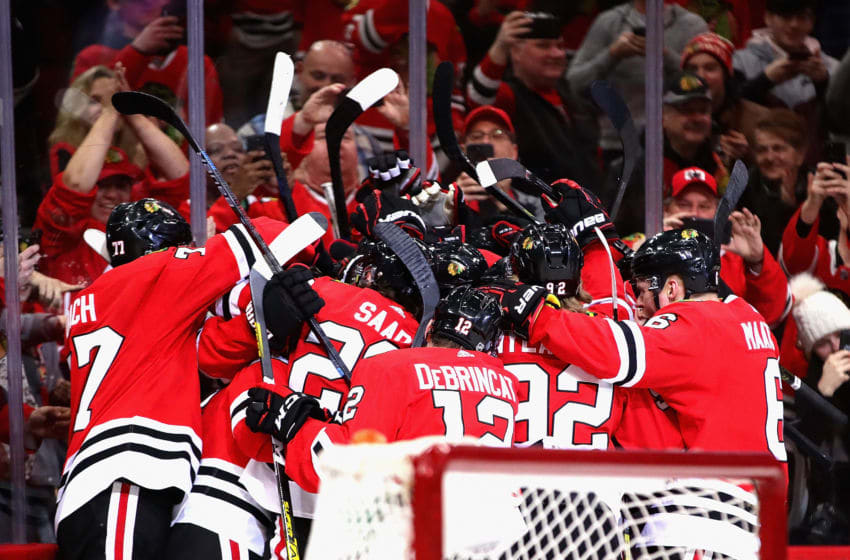 CHICAGO, ILLINOIS - JANUARY 19: Members of the Chicago Blackhawks mob teammate Patrick Kane after getting his 1000th career point on an assist on a goal by Brandon Saad in the third period with against the Winnipeg Jets at the United Center on January 19, 2020 in Chicago, Illinois. The Blackhawks defeated the Jets 5-2. (Photo by Jonathan Daniel/Getty Images)