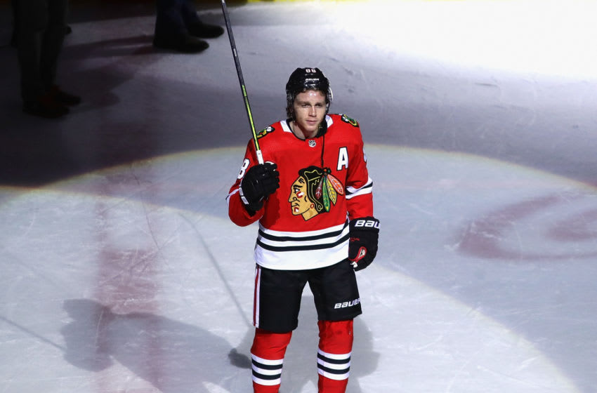 CHICAGO, ILLINOIS - JANUARY 19: Patrick Kane #88 of the Chicago Blackhawks acknowledges the crowd after getting his 1000th career point on an assist on a goal by Brandon Saad in the third period with against the Winnipeg Jets at the United Center on January 19, 2020 in Chicago, Illinois. The Blackhawks defeated the Jets 5-2. (Photo by Jonathan Daniel/Getty Images)
