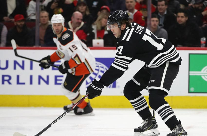 CHICAGO, ILLINOIS - MARCH 03: Dylan Strome #17 of the Chicago Blackhawks breaks up the ice past Ryan Getzlaf #15 of the Anaheim Ducks at the United Center on March 03, 2020 in Chicago, Illinois. (Photo by Jonathan Daniel/Getty Images)