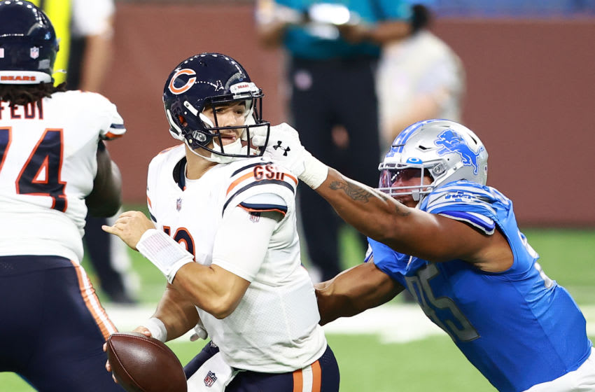 DETROIT, MI - SEPTEMBER 13: Romeo Okwara #95 of the Detroit Lions grabs the facemask of Mitchell Trubisky #10 of the Chicago Bears in the fourth quarter at Ford Field on September 13, 2020 in Detroit, Michigan. (Photo by Rey Del Rio/Getty Images)