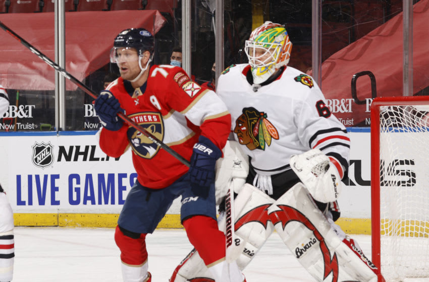 SUNRISE, FL - JANUARY 17: Patric Hornqvist #70 of the Florida Panthers gets into position for a tip in attempt in front of Goaltender Collin Delia #60 of the Chicago Blackhawks at the BB&T Center on January 17, 2021 in Sunrise, Florida. (Photo by Joel Auerbach/Getty Images)