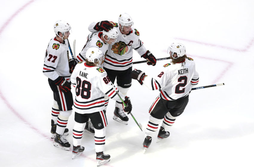EDMONTON, ALBERTA - AUGUST 01: Dominik Kubalik #8 of the Chicago Blackhawks is congratulated by teammates Jonathan Toews #19, Patrick Kane #88, Kirby Dach #77 and Duncan Keith #2 after Kubalik scored on a power play in the second period during Game One of the Western Conference Qualification Round prior to the 2020 NHL Stanley Cup Playoffs at Rogers Place on August 01, 2020 in Edmonton, Alberta. (Photo by Jeff Vinnick/Getty Images)