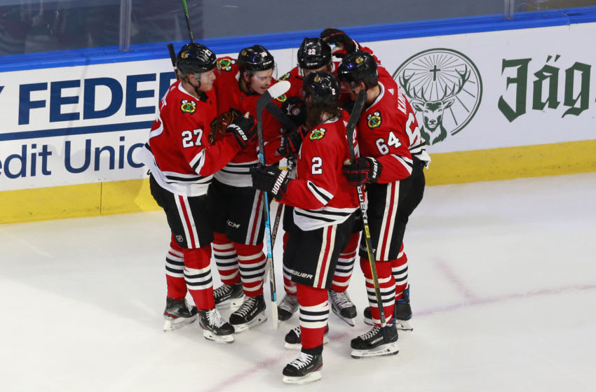 EDMONTON, ALBERTA - AUGUST 07: Matthew Highmore #36 of the Chicago Blackhawks is congratulated by his teammates after scoring a goal against the Edmonton Oilers during the first period in Game Four of the Western Conference Qualification Round prior to the 2020 NHL Stanley Cup Playoffs at Rogers Place on August 07, 2020 in Edmonton, Alberta. (Photo by Jeff Vinnick/Getty Images)