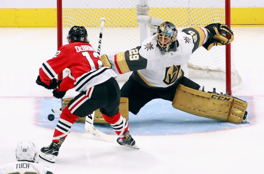 EDMONTON, ALBERTA - AUGUST 15: Marc-Andre Fleury #29 of the Vegas Golden Knights makes the second period save on Alex DeBrincat #12 of the Chicago Blackhawks in Game Three of the Western Conference First Round during the 2020 NHL Stanley Cup Playoffs at Rogers Place on August 15, 2020 in Edmonton, Alberta, Canada. (Photo by Jeff Vinnick/Getty Images)