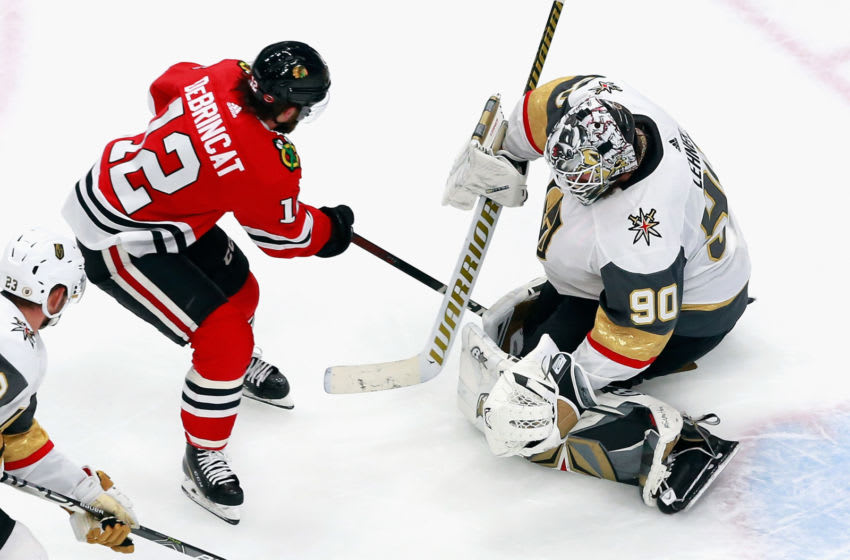 EDMONTON, ALBERTA - AUGUST 16: Robin Lehner #90 of the Vegas Golden Knights makes the save on Alex DeBrincat #12 of the Chicago Blackhawks with two minutes remaining in the third period in Game Four of the Western Conference First Round during the 2020 NHL Stanley Cup Playoffs at Rogers Place on August 16, 2020 in Edmonton, Alberta, Canada. (Photo by Jeff Vinnick/Getty Images)