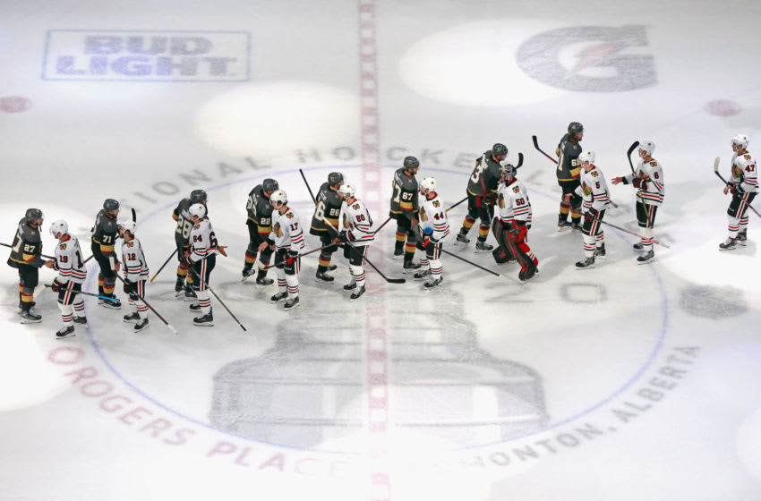 EDMONTON, ALBERTA - AUGUST 18: The Vegas Golden Knights and the Chicago Blackhawks shake hands after the Golden Knights victory in Game Five of the Western Conference First Round during the 2020 NHL Stanley Cup Playoffs at Rogers Place on August 18, 2020 in Edmonton, Alberta, Canada. The Golden Knights defeated the Blackhawks 3-2 to win the series 4-1.