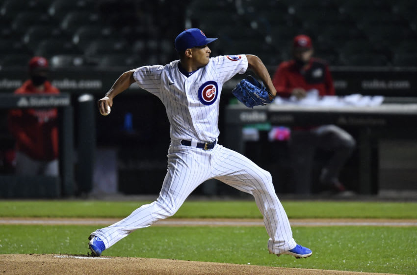 CHICAGO, ILLINOIS - SEPTEMBER 10: Starting pitcher Adbert Alzolay #73 of the Chicago Cubs throws the baseball in the first inning against the Cincinnati Redsat Wrigley Field on September 10, 2020 in Chicago, Illinois. (Photo by Quinn Harris/Getty Images)