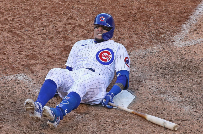 CHICAGO, ILLINOIS - OCTOBER 02: Javier Baez #9 of the Chicago Cubs hits the ground after fouling a ball off of himself in the 9th inning against the Miami Marlins during Game Two of the National League Wild Card Series at Wrigley Field on October 02, 2020 in Chicago, Illinois. The Marlins defeated the Cubs 2-0. (Photo by Jonathan Daniel/Getty Images)