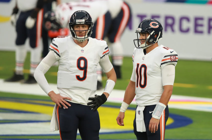 INGLEWOOD, CALIFORNIA - OCTOBER 26: Nick Foles #9 of the Chicago Bears and Mitchell Trubisky #10 chat during warmup prior to the start of the game against the Los Angeles Rams at SoFi Stadium on October 26, 2020 in Inglewood, California. (Photo by Joe Scarnici/Getty Images)
