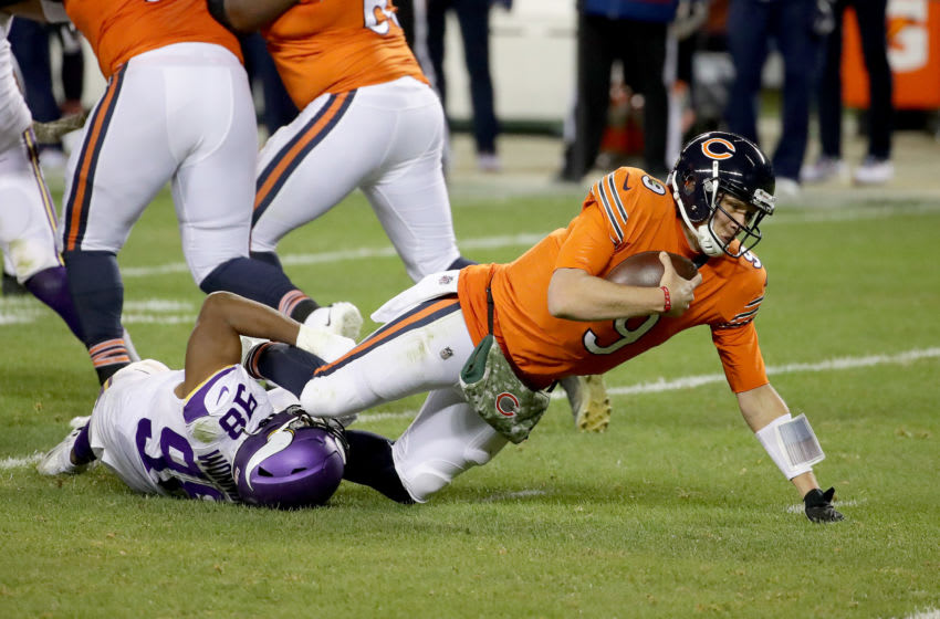 CHICAGO, ILLINOIS - NOVEMBER 16: Nick Foles #9 of the Chicago Bears is sacked by D.J. Wonnum #98 of the Minnesota Vikings in the third quarter of the game at Soldier Field on November 16, 2020 in Chicago, Illinois. (Photo by Jonathan Daniel/Getty Images)