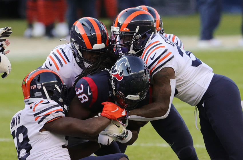CHICAGO, ILLINOIS - DECEMBER 13: Houston Texans running back Buddy Howell #38 is gang tackled by the Chicago Bears defense during the second half at Soldier Field on December 13, 2020 in Chicago, Illinois. (Photo by Jonathan Daniel/Getty Images)