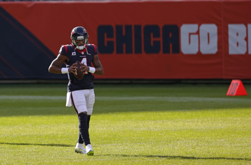 CHICAGO, ILLINOIS - DECEMBER 13: Deshaun Watson #4 of the Houston Texans participates in warmups prior to a game against the Chicago Bears at Soldier Field on December 13, 2020 in Chicago, Illinois. The Bears defeated the Texans 36-7. (Photo by Stacy Revere/Getty Images)